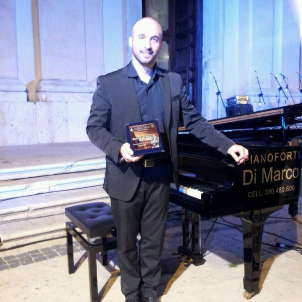"Claudio Di Meo receiving First Prize at the ""International Competition Enrico Caruso""."